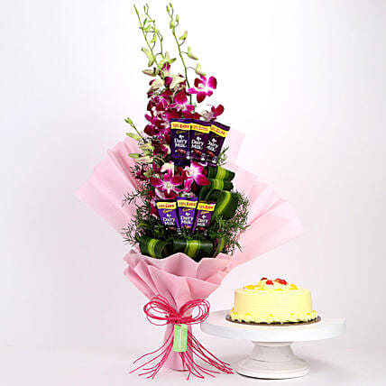 Online Dairy Milk Orchids Bouquet And Butterscotch Cake