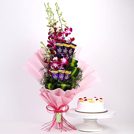 Online Dairy Milk Orchids Bouquet And Pine Apple Cake:Cakes and Chocolates