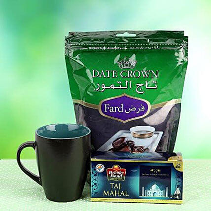 500 g pack of Crown Date, a coffee mug & 25 tea bags Taj Mahal