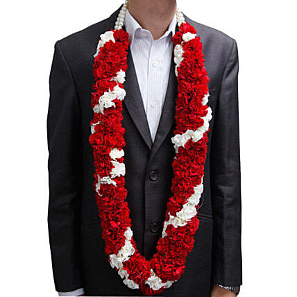 A garland with red and white carnations, and white pearls:Buy Floral Jewelery