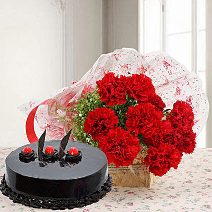Mouthwatering Truffle Cake With Flower:Flower Delivery in Dindigul