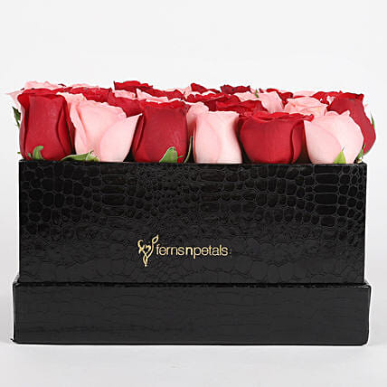 combo of 2 roses in black box arrangement:Flowers for Janmashtami