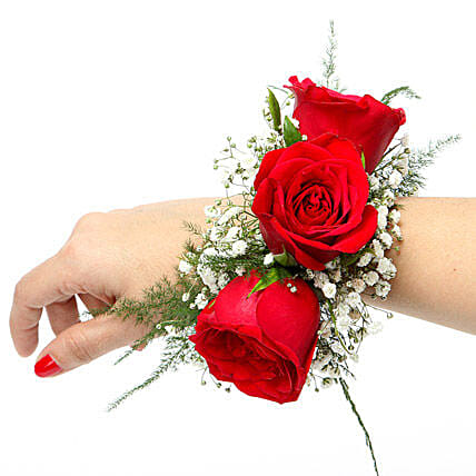 A floral bracelet of red roses and gypsophila:Flower Jewellery