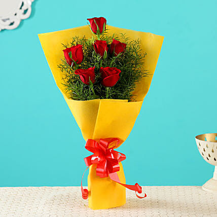 Order Red Roses In Yellow Paper