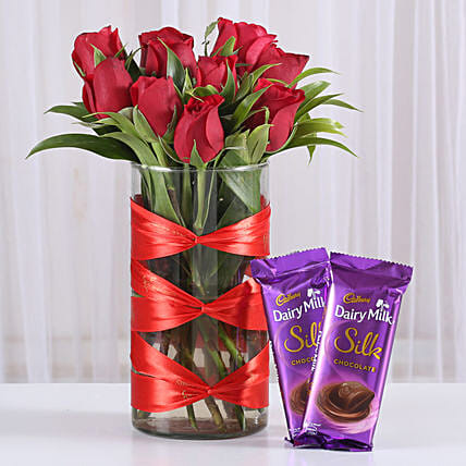 Roses in attractive vase with silk chocolates