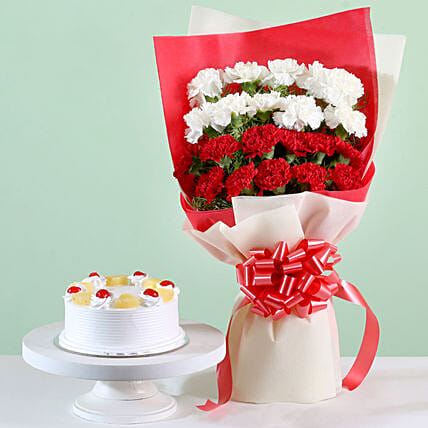 Red & White Carnations With Pineapple Cake:Cake and Flower Delivery