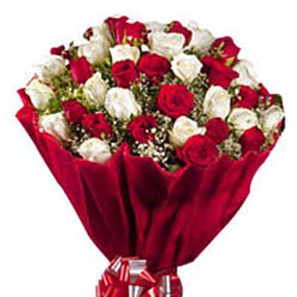 Romantic Tickle - Bunch of 50 red and  roses in paper packing.
