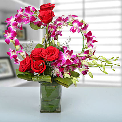 Red rose, purple orchid arrangement
