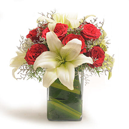 Roses N Lilies - Glass vase arrangement of 10 red roses with 2 lilies.