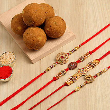 Set Of 4 Designer Rakhis & Besan Laddu