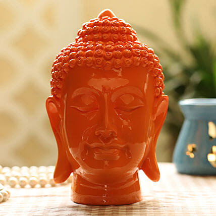 orange colour buddha idol