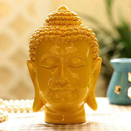 yellow colour buddha idol:Idols
