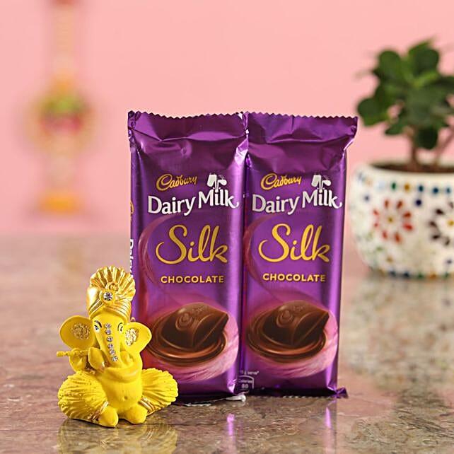 Silk Chocolate Yellow Ganesha Idol:Send Diyas