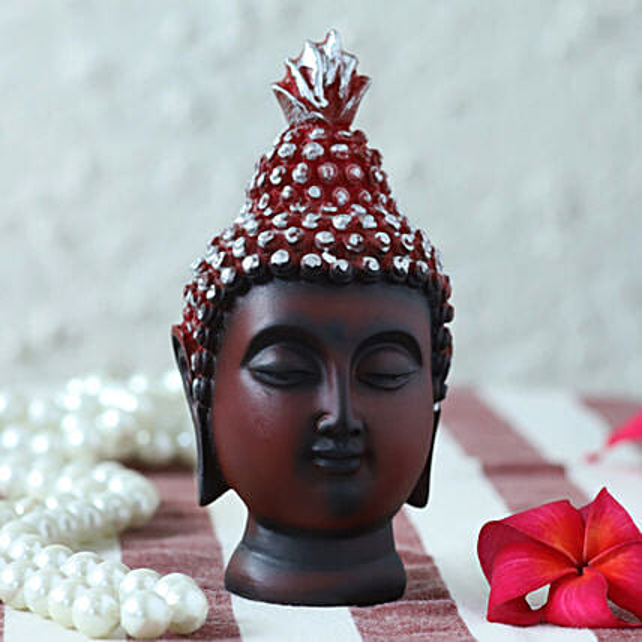 small red head buddha idol