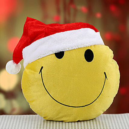 Smiley cushion with santa cap