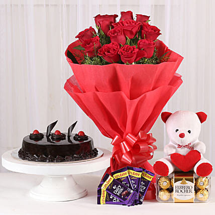 Some One Special - Bunch of 12 Red Roses with 5 cadbury chocolates, Soft toy, Ferrero Rocher and 500gm Chocolate Cake.:Roses And Teddies