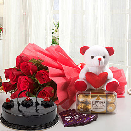 Some One Special - Bunch of 12 Red Roses with 5 cadbury chocolates, Soft toy, Ferrero Rocher and 500gm Chocolate Cake.:Flowers & Teddy Bears for Anniversary