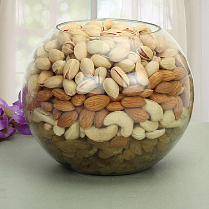 Glass vase filled with dry fruits:Gifts for Lohri