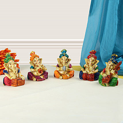 Five small Ganeshas playing instruments