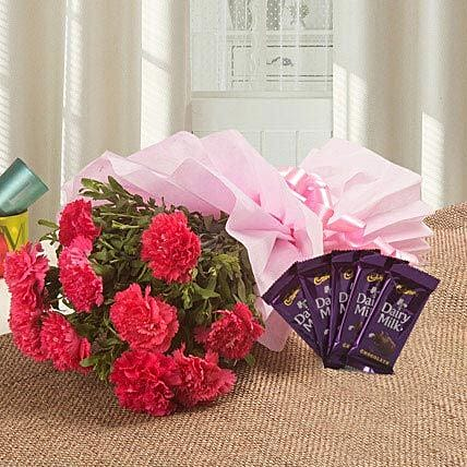 Spoil Rotten With Flowers N Flavours - Bunch of 10 pink carnations and 5 Dairymilk chocolates 13 grams each.:Flowers N Chocolates - anniversary