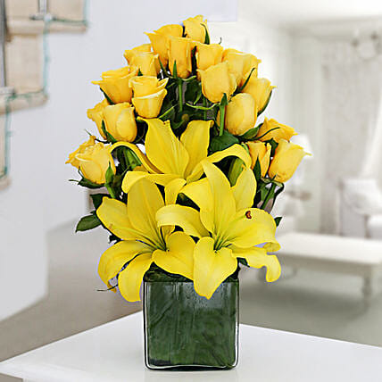 Glass vase arrangement of 20 yellow roses and 3 yellow asiatic lilies flowers gifts:Wedding Gifts Bengaluru