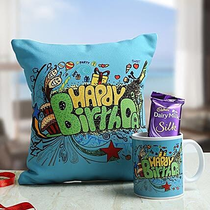 A hamper of cushion, cadbury dairy milk silk chocolate and white coffee mug