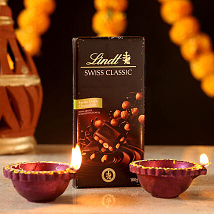 décor candle with chocolates for diwali