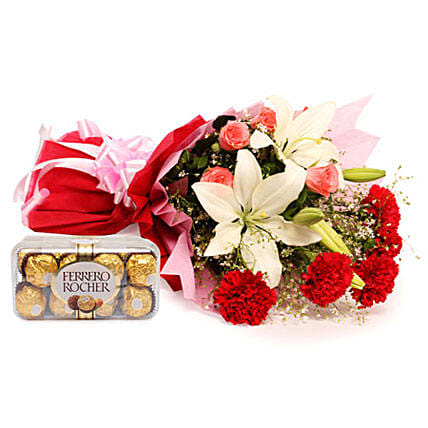 Sweetest Of All - Bunch of 2  Asiatic Lilies, 5 Red Carnations and 5 Pink Roses in a two layer paper packing and 200 grams Ferrero Rocher chocolates.:Send Thank You Chocolates
