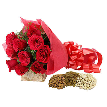 Gift hamper of red roses bouquet with dry fruits