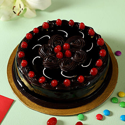 truffle cake with cherry topper