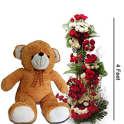 Unconditional Pure Love - 4 Feet tall arrangment of 50 Red Roses, 25 Roses, 50 Red Carnitions & 25 White carnations with 3 feet tall Teddy Bear.