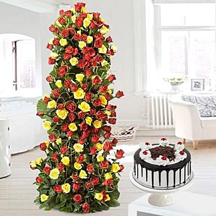 Unlimited Love - Arrangement of 100 Red N Yellow roses of 3-4 ft height with 1kg Black forest cake.:Premium Gifts