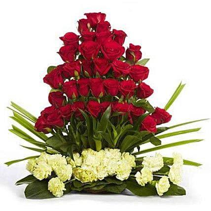 Classic Celebrations - Arrangement of 30 red roses with 20 yellow carnations.