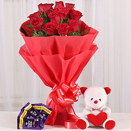 Cuddly Affair - bunch of 12 red roses with 6 inch teddy and 5 Cadbury Dairymilk .:Send Soft toys to Delhi