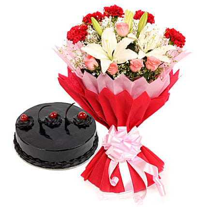 Enchanted Bloom - Bunch of 2  Asiatic Lilies, 5 Red Carnations and 5 Pink Roses in a two layer paper packing and half kg truffle gifts:Anniversary Gifts Bikaner