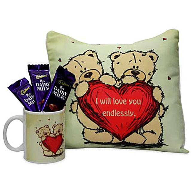 Warm and Cozy Love Hamper-12x12 inches cushion, printed coffee mug,3 Cadbury Dairymilk chocolates 18 grams each