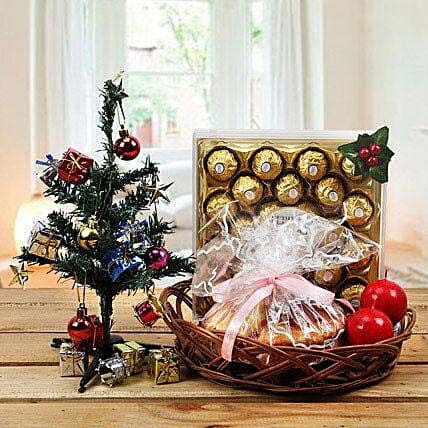 Chocolates, artificial christmas tree, candles and cake combo