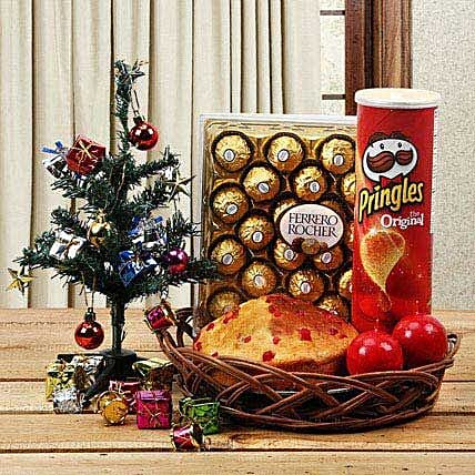 Cake, chocolates, chips, candles and christmas tree combo