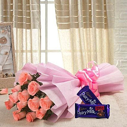 Sweet Elegance - Bunch of 12 baby pink roses with 2 Fruit n nut chocolates.
