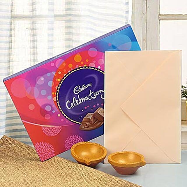 Chocolate with greeting card and diyas