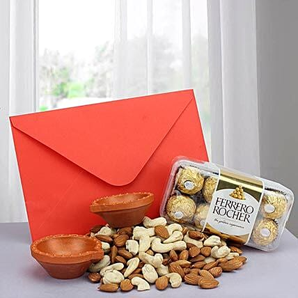 Combo of dry fruits, sweets, diyas and a greeting card