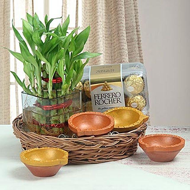Chocolates, lucky bamboo and diyas combo