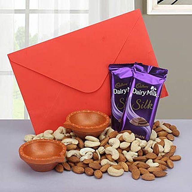 Gift hamper of chocolates, diyas, dry fruits and a greeting card