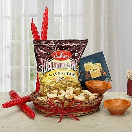 Gift hamper of mixture, sweets,  dry fruits, candles and diyas