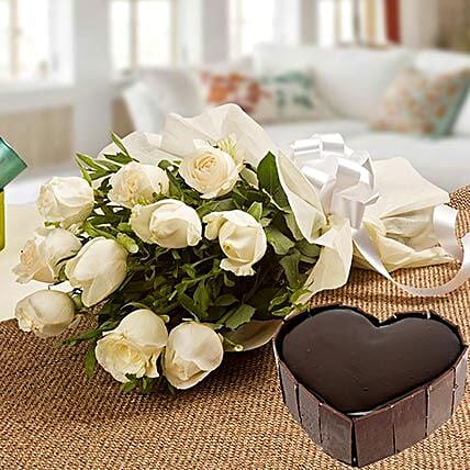 Heavenly Love - Bunch of 10 white roses in a paper packing and 1 kg of heart shaped chocolate cake.