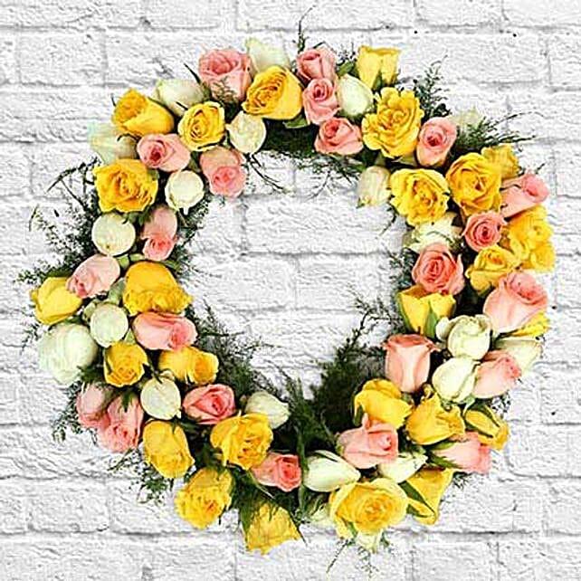 Roses and seasonal filler in wreath:Send Christmas Gifts to Mumbai