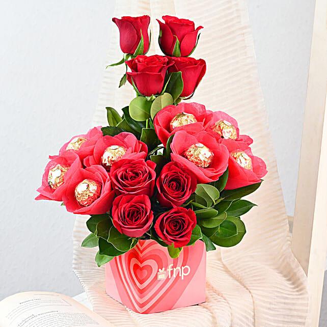 Glass vase arrangement of roses and ferrero rochers