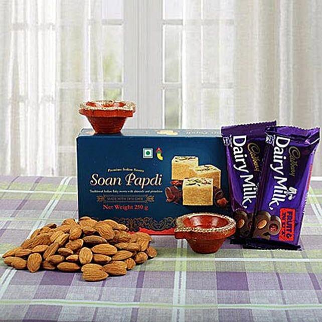 Gift hamper of chocolates, sweets, dry fruits and diyas