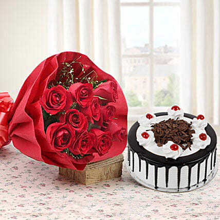 My Sweet Bouquet - Bunch of 10 red roses in paper packing and half kg blackforest cake.
