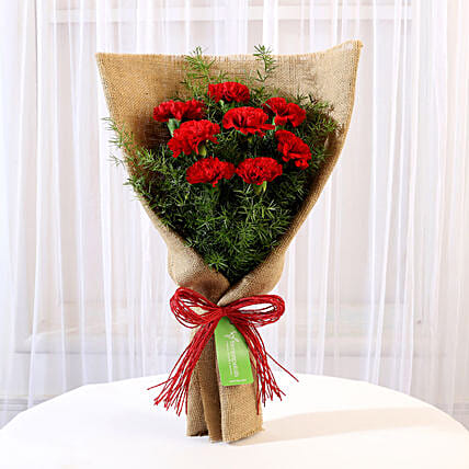8 Red Carnations Bouquet in Jute